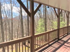Rear Covered Deck with Wooded/Mountain View